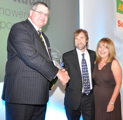 Sean Larter-Conway of Stihl presents Award to Brian and Sue Radam